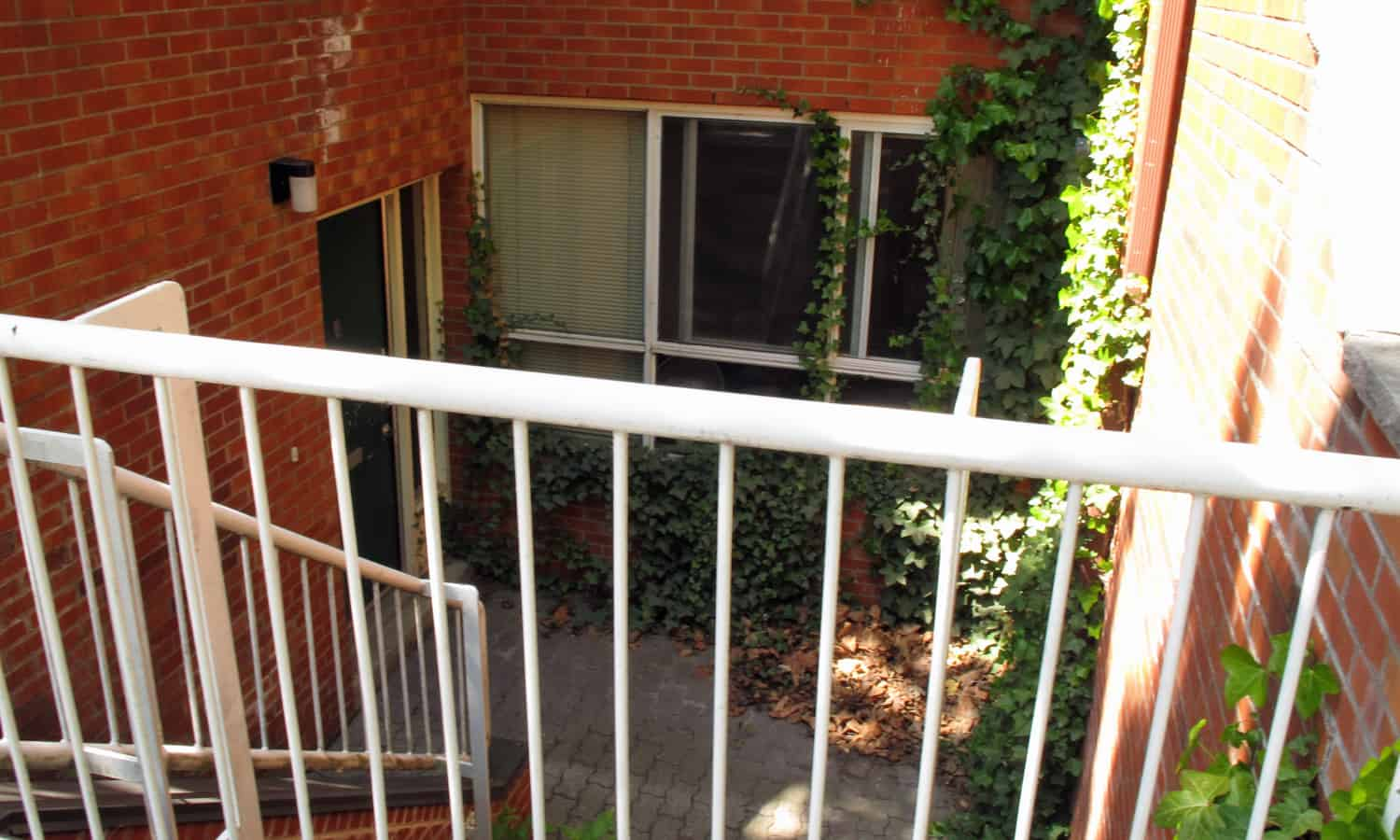 Sunken entry and small courtyard along Henry Street