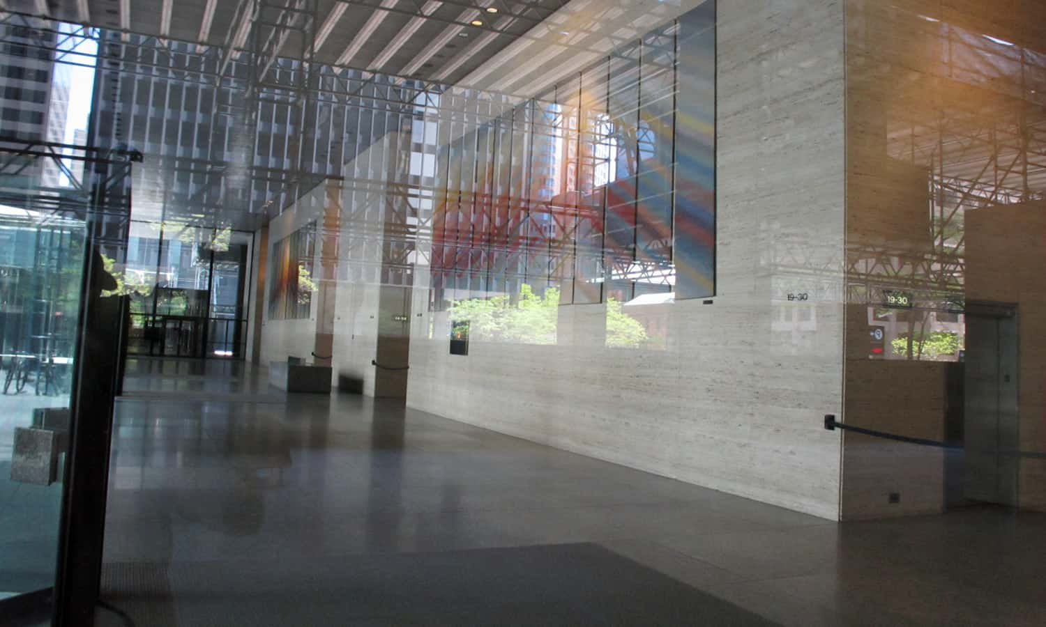 Looking into one of the tower lobby complete with travertine service core cladding