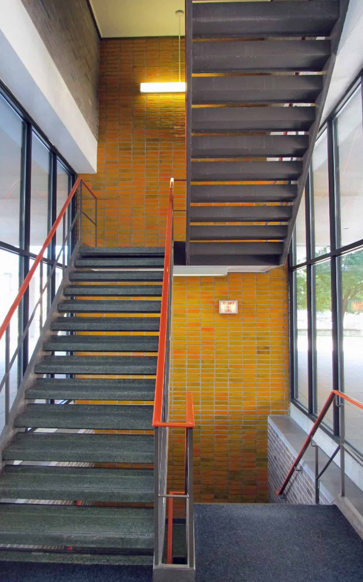 Ground floor stairwell (glazed brick, plate glass, terrazzo flooring)