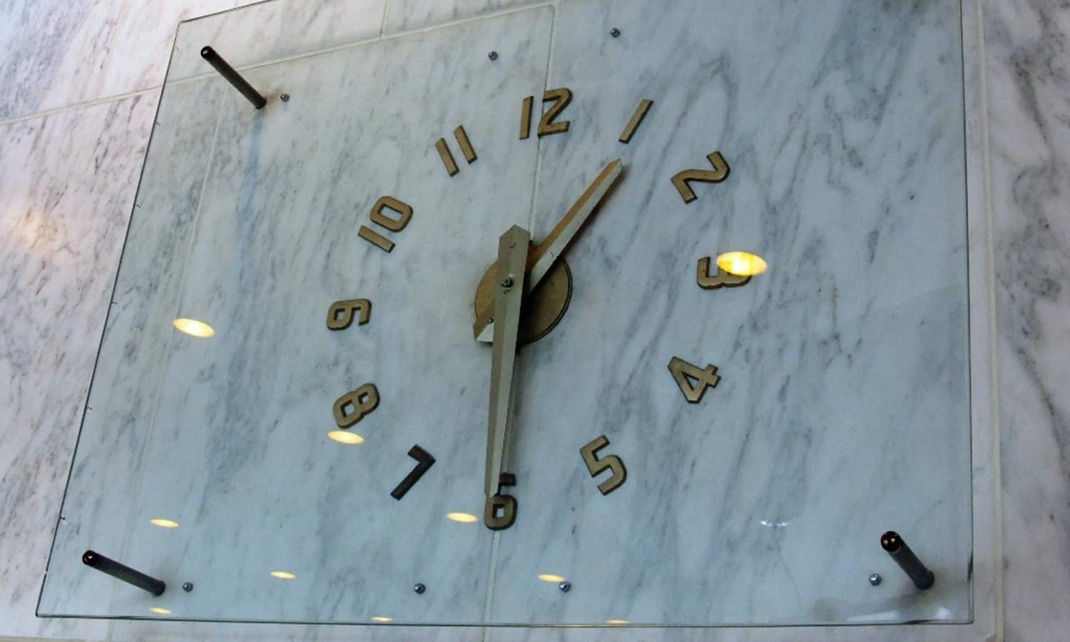 Main foyer wall clock (marble wall panels)