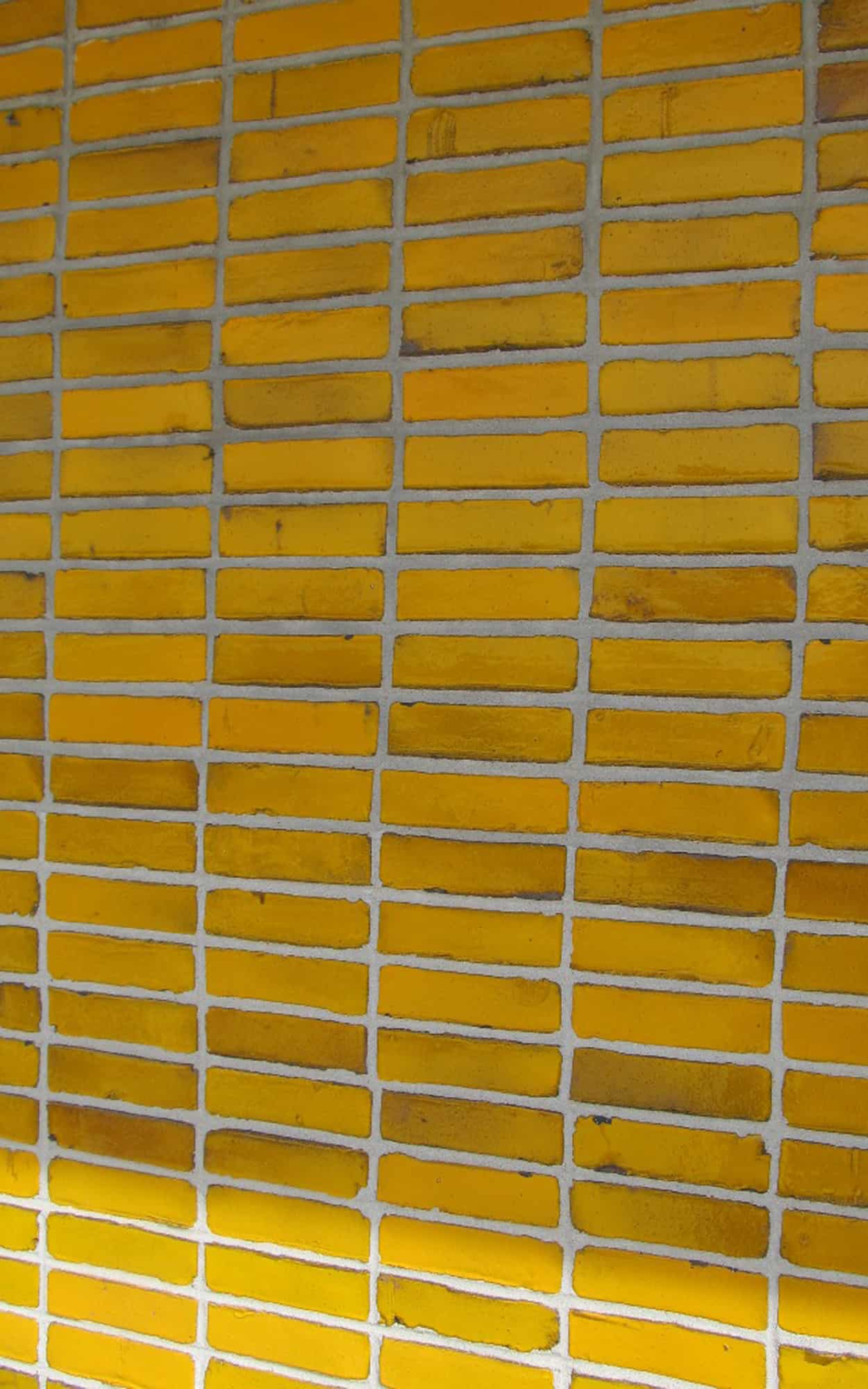 Yellow glazed brick wall, ground floor