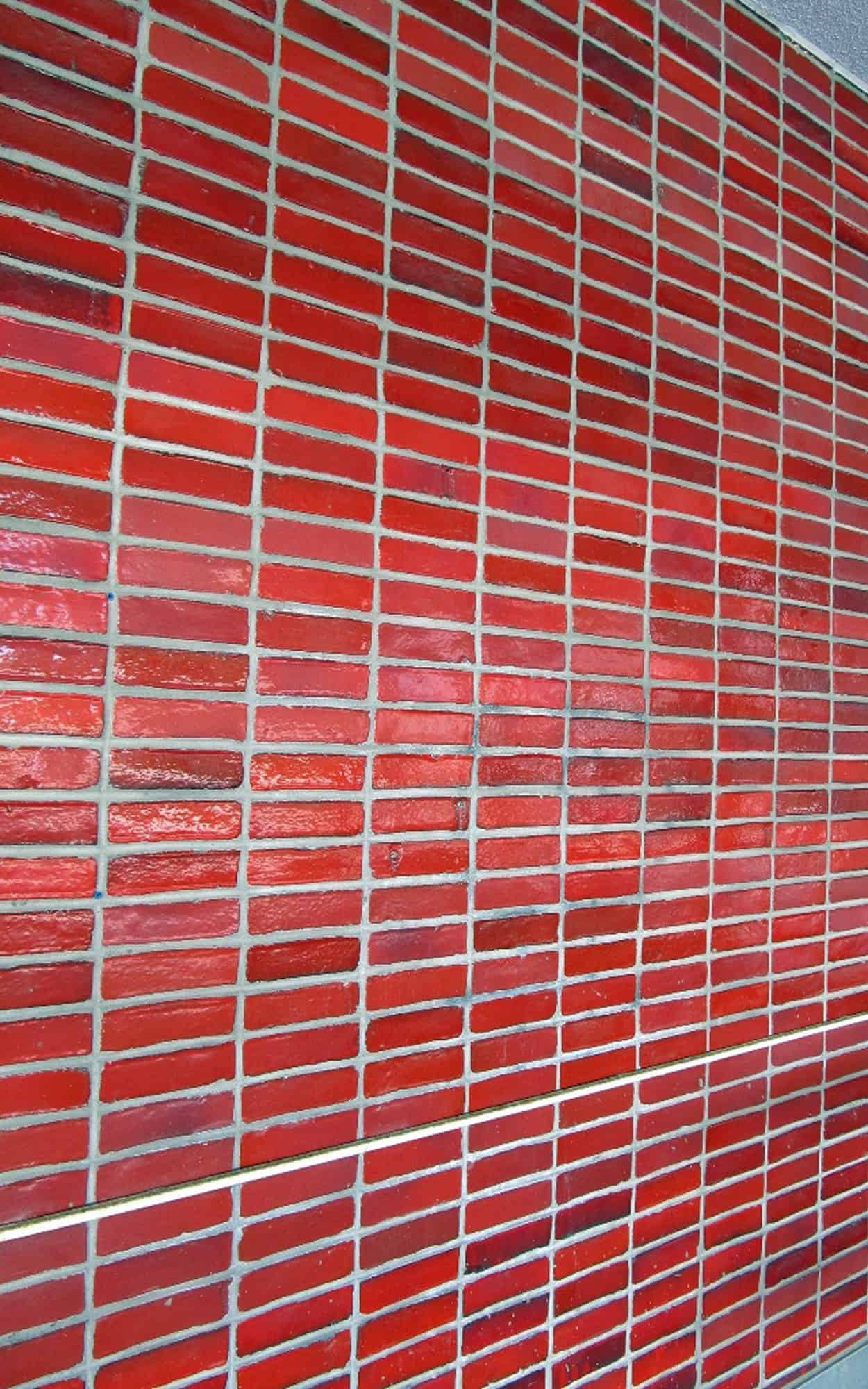 Red glazed brick wall, rear centre block, ground floor