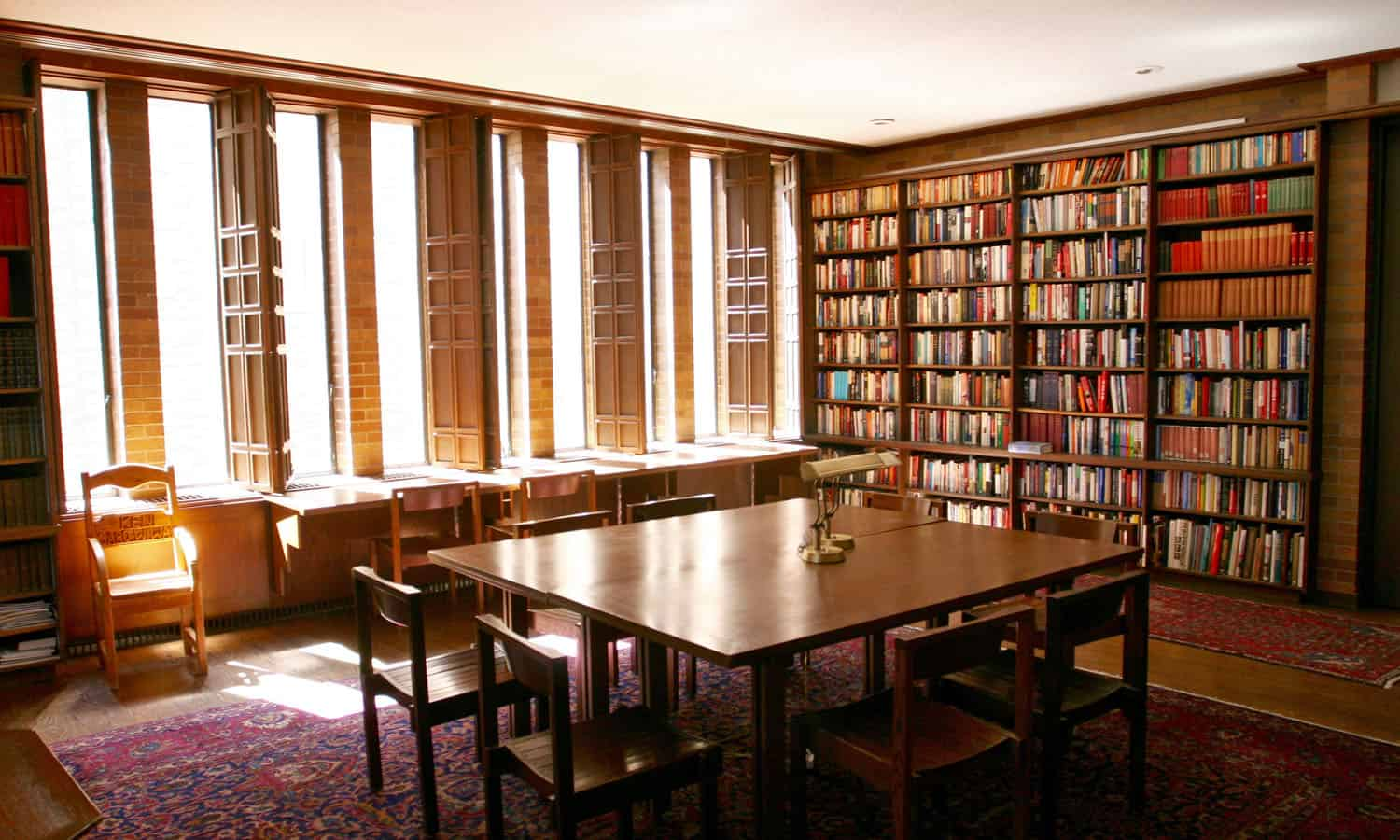 The intimate library with its book-lined, brick walls and wooden shutters (James Wagner)