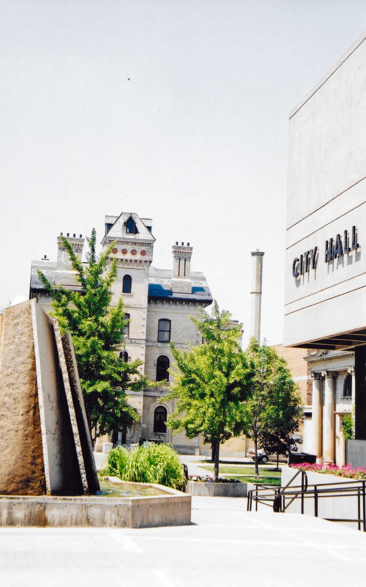 Detail of the fountain located in the middle of the square wit the Brantford County Courthouse in the background