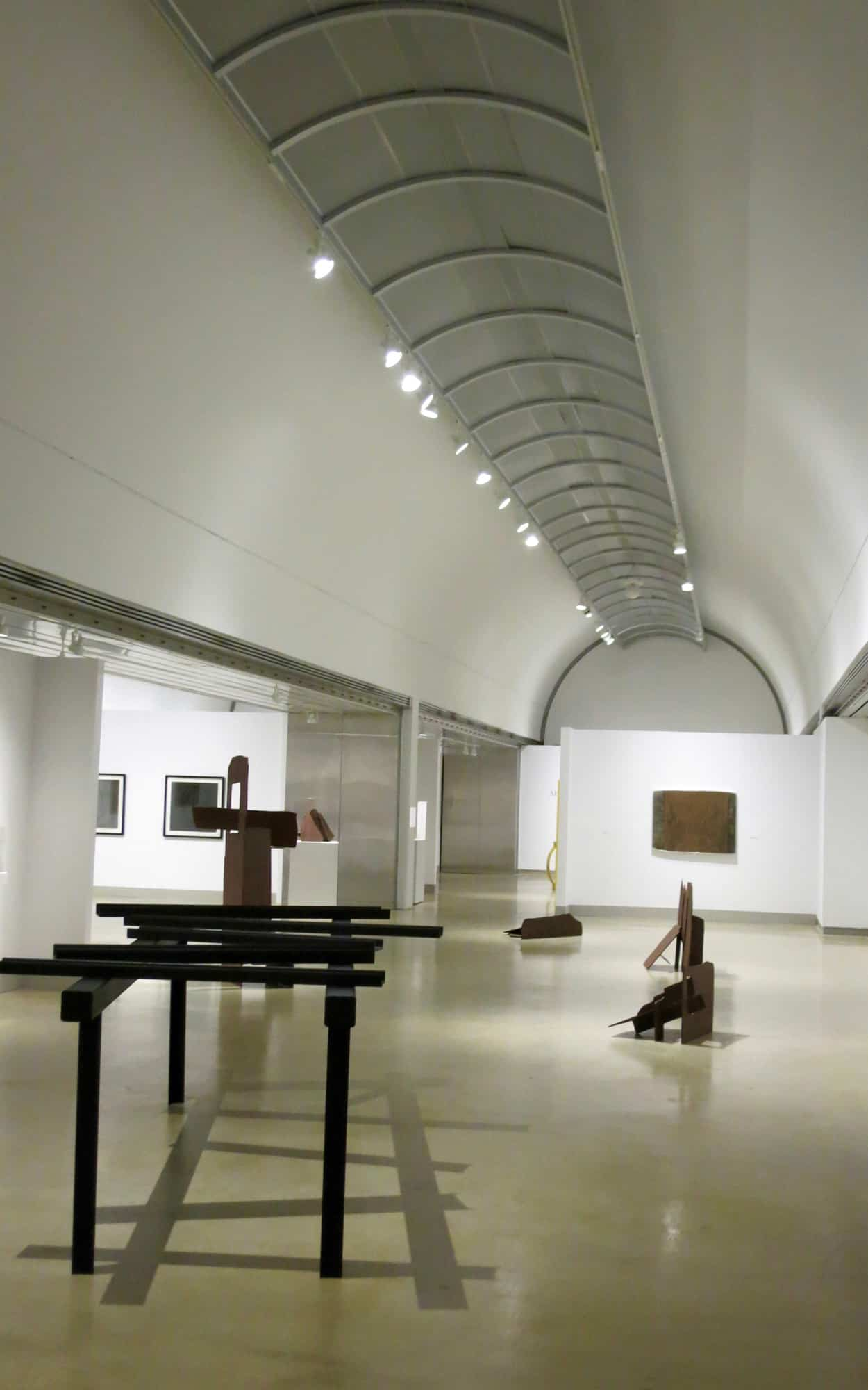 Exposed concrete vaults within a gallery space since painted white