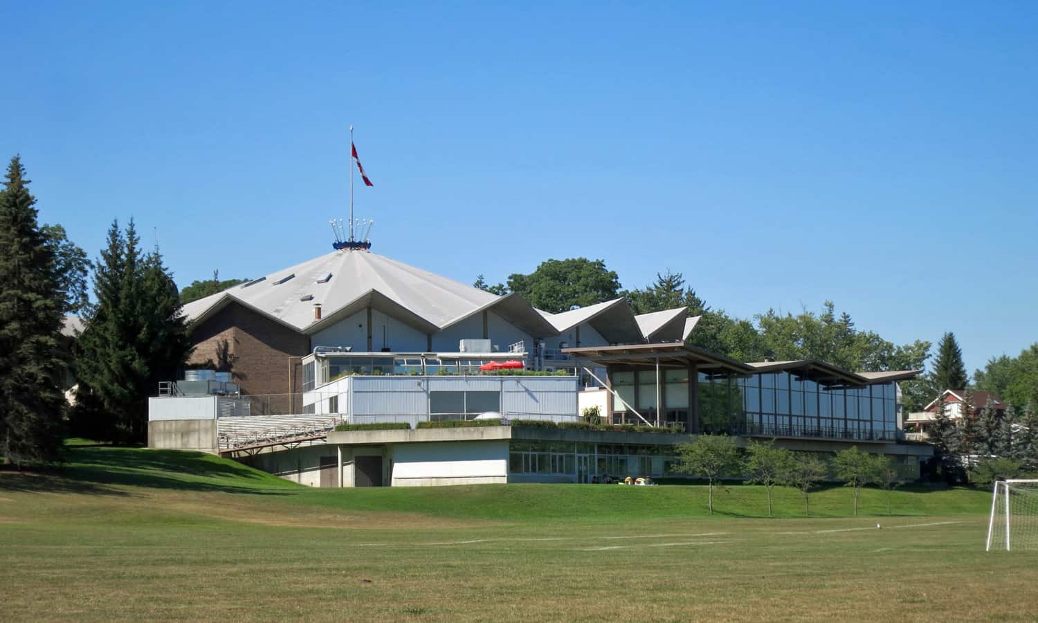 Festival Theatre and its additions overlooking parkland and Avon River