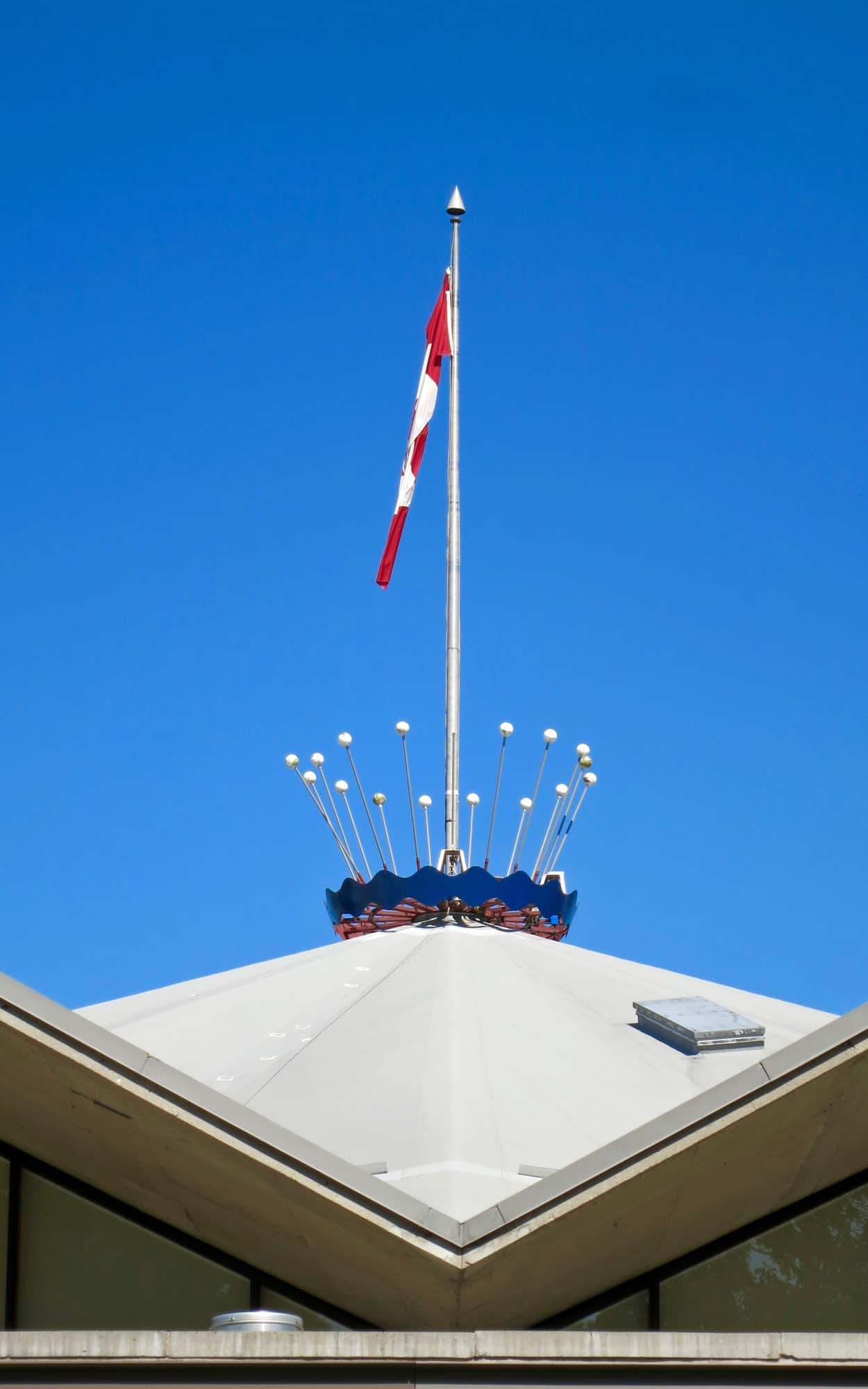 Roof-top flagpole and coronet finial