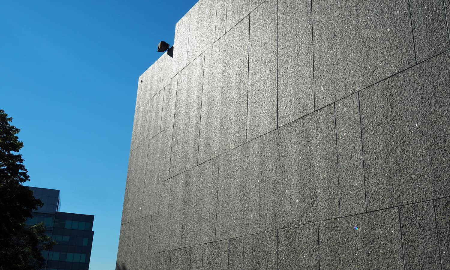 Detail of the granite cladding in the sunlight
