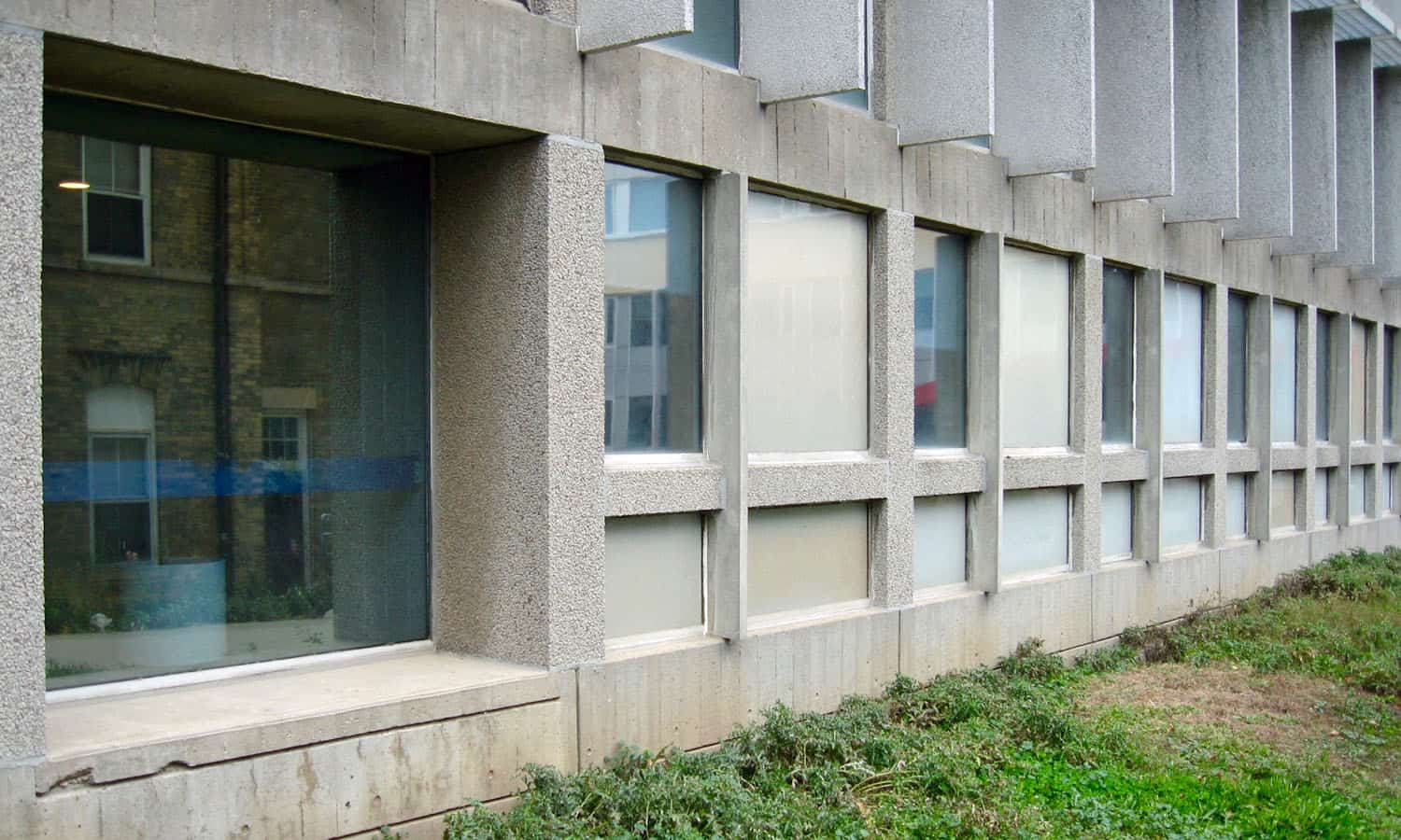 The east facade with considerable depth and texture achieved by precast and poured-in place concrete