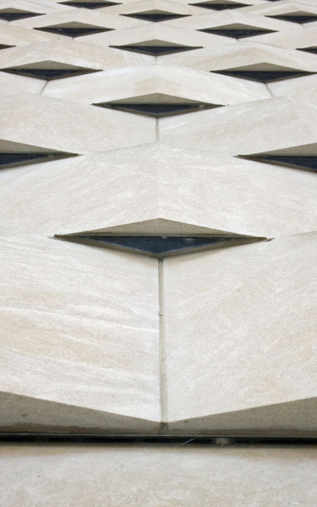 The limestone cladding of the justice building with its subtle basket-weave effect