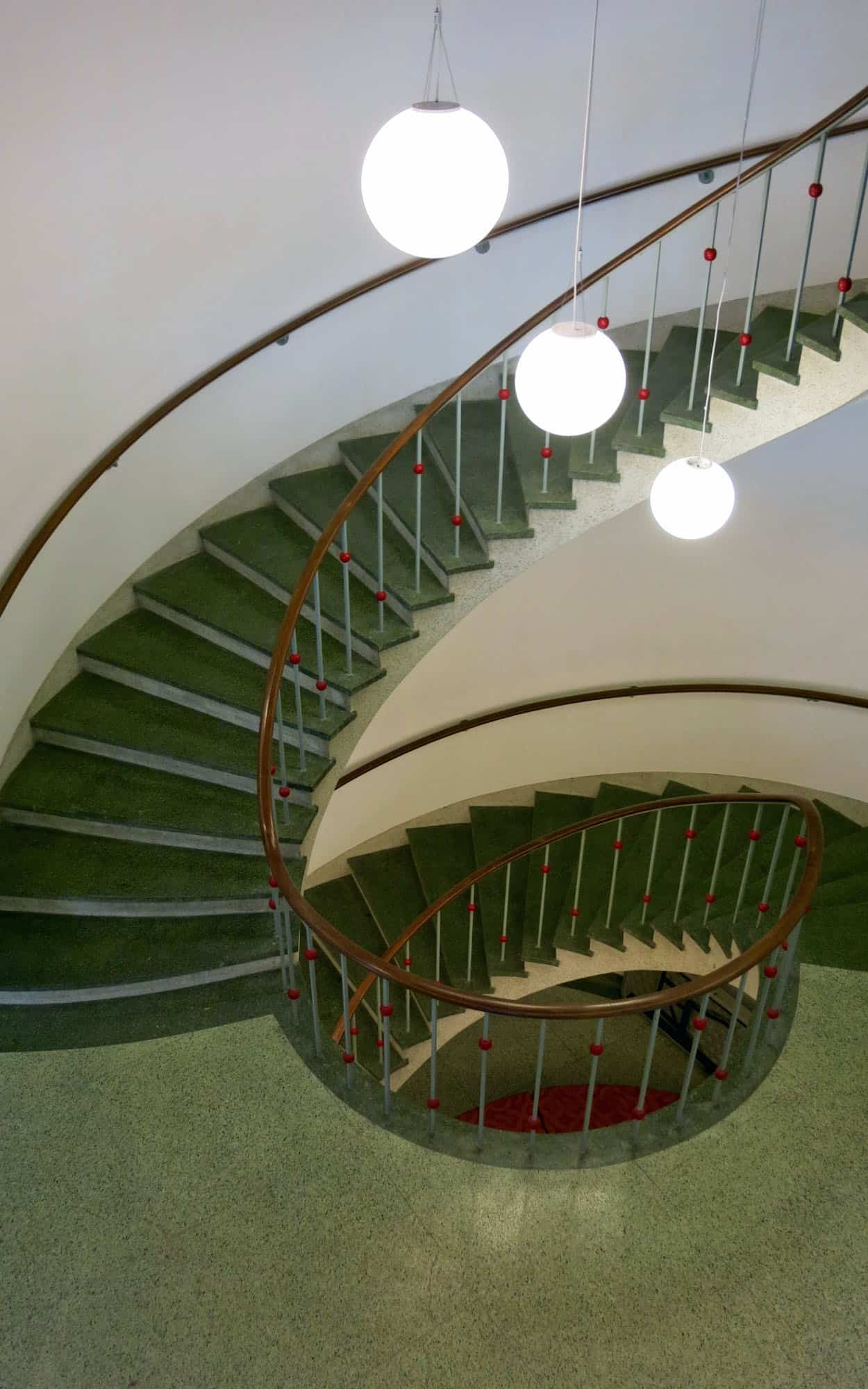 The dramatic, cantilevered, curvilinear stair connecting all three floors