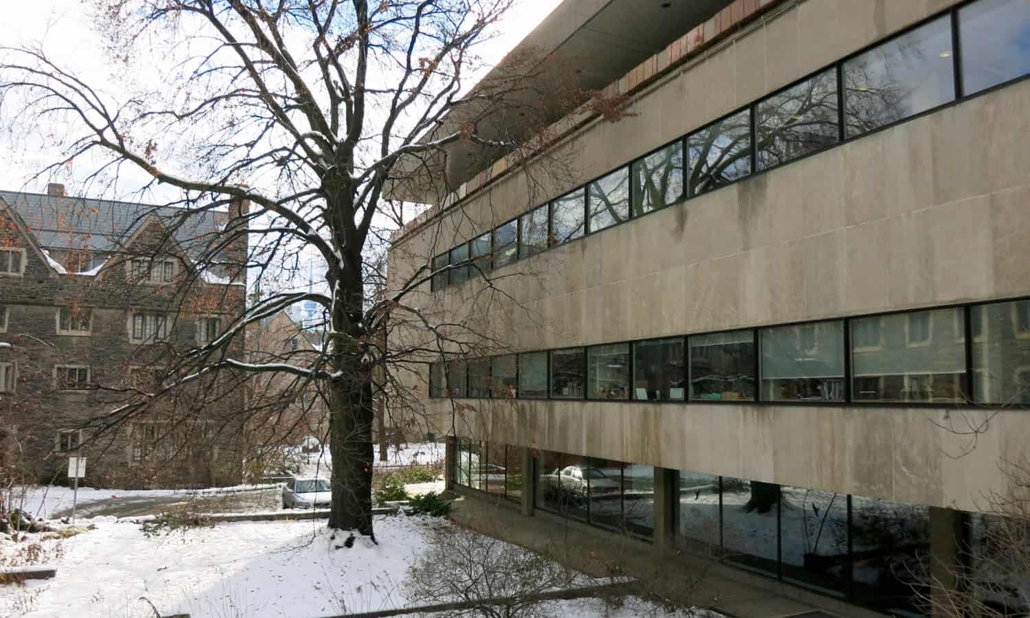 Ribbon windows on the east elevation provide views of Burwash Residence (1931) and the Lester B. Pearson Garden for Peace and Understanding
