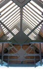 SHELTER The wooden trusses are illuminated by translucent panels in the roof above