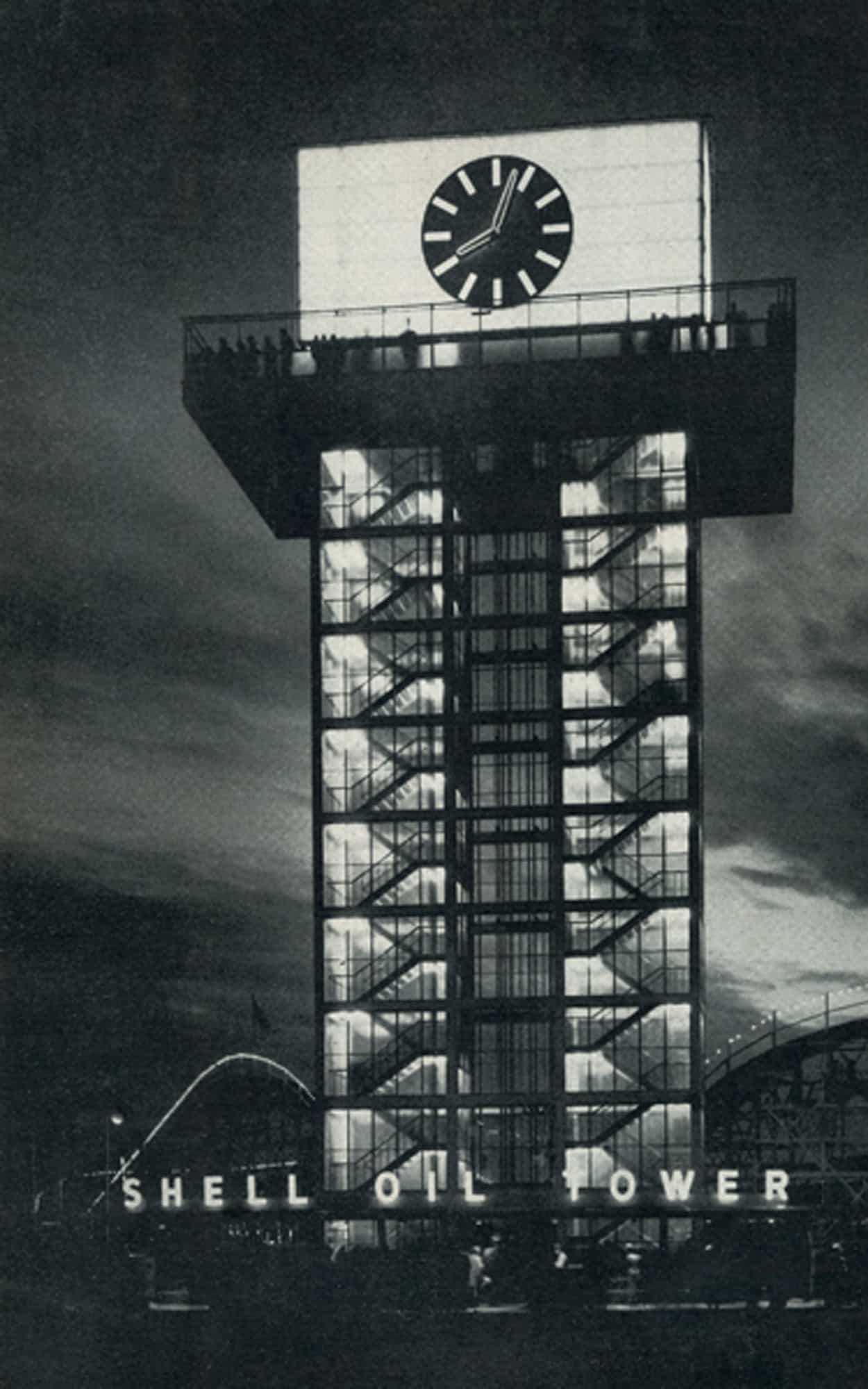 A night view with the illumination emphasizing the transparency of the tower, and the beacon-like quality of the clock (Panda Associates)