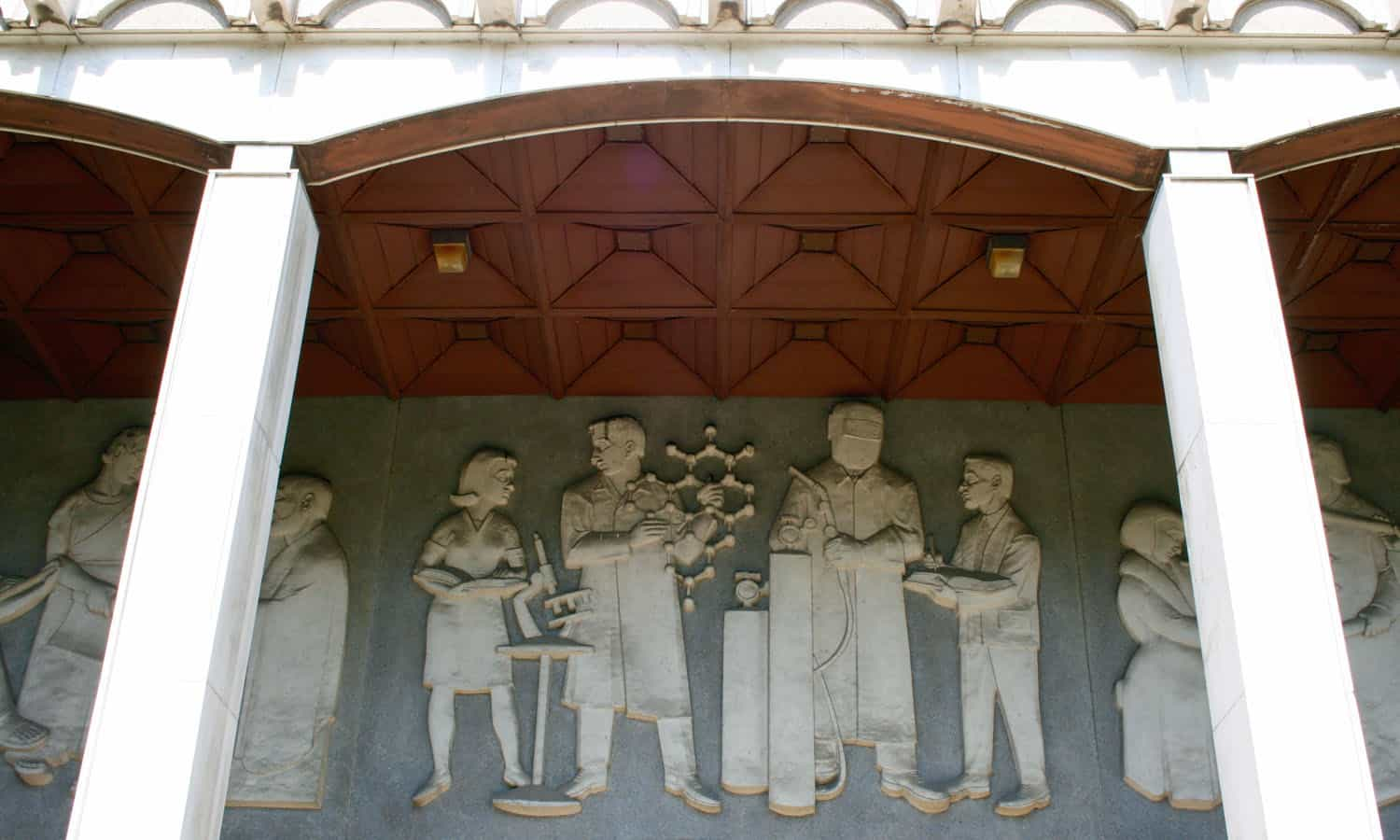 The concrete bas-relief by Joseph Gause featured education in three stages; ancient, renaissance, and modern