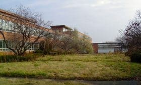 The largest of the 14 buildings was the 4-storey hospital, shown here following the closure of the facility (Unterman McPhail)