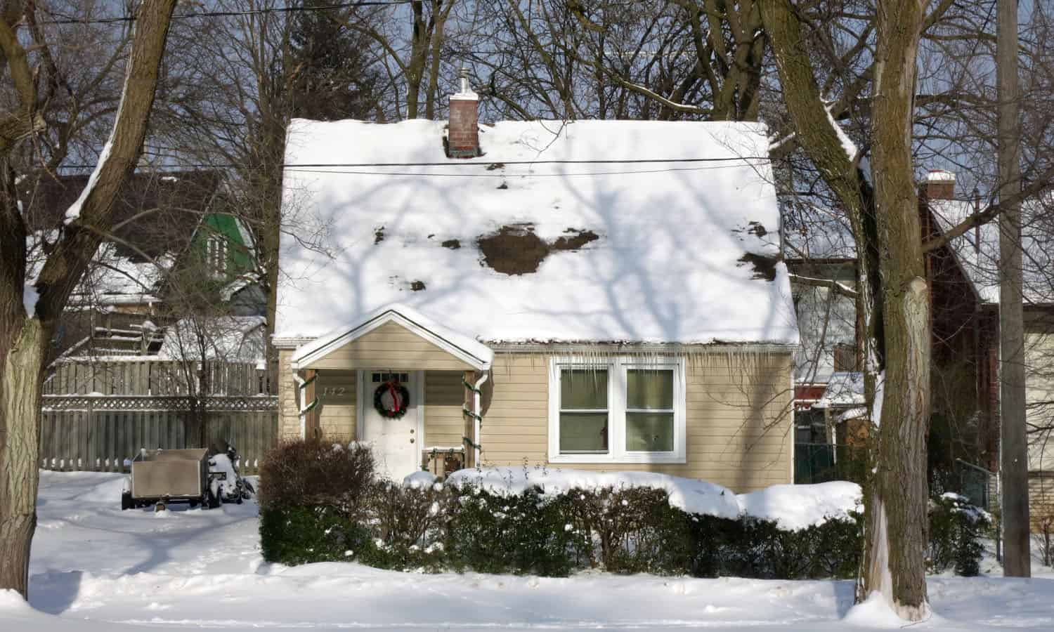 This typical house on Spadina Road East is characterized by its compact, rational plan, its modest size, its steep gabled roof, and its small porch